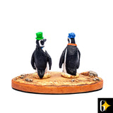 Perspective view of the figurine portraying a pair of penguins wearing hats. Buy this African curio now.