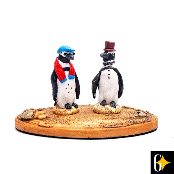 Top view of the dressed penguin pair figurine. Buy this African gift now.