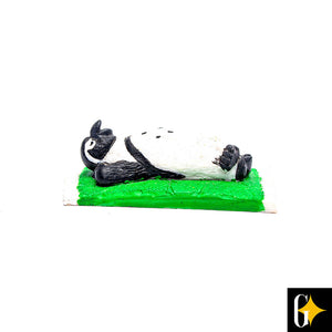 Top view of the lounging penguin figurine. Buy this African gift now.