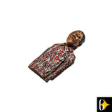 Perspective view of the magnet of Nelson Mandela in a red shirt. Buy this African curio now.