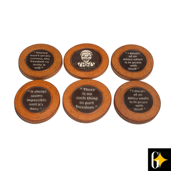 Top view of the dark brown coasters bearing Mandela quotes. Buy this African gift now.