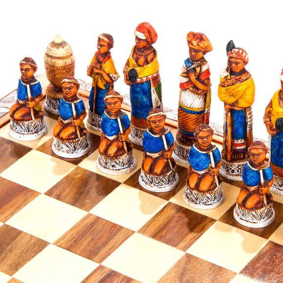 A close-up view of the colourful mini African tribal chess set. These chess pieces have been hand-painted in beautiful vibrant colours to reflect the culture and the people of Africa.
