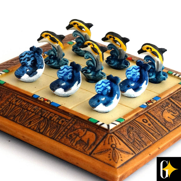 Close up image of the whale and dolphin Tic Tac Toe set and playing pieces.