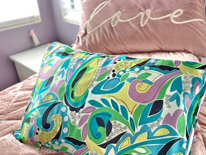 Bye-Bye Bed Head! Innovative Silked Pillow Sleeve is a beauty must-have for FabFitFun customers, travel or at home! Saves skin, hair from the friction of absorbent cotton pillowcases. Open-end, 100% Poly-Satin Charmeuse Front 95% Rayon 5% Spandex, anti-slip jersey back. Beauty Benefits, Made in USA, by two mix chicks.