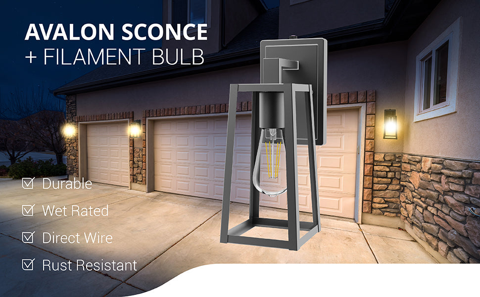 Avalon Caged Wall Sconce with ST64 Filament Bulb is durable and wet rated for exterior use. Easily install the black, metal frame as a direct wire fixture. This Wall Sconce offers a waterproof, durable housing that is both anti-rust and anti-corrosion for wet rated areas. Image shows several Avalon Wall Sconces on the exterior of a house near garage doors to light up the driveway.