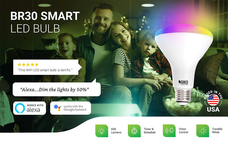 Control your lights with your voice and the Sunco Lighting BR30 LED Smart Bulb. Voice Control works with Amazon Alexa and Google Assistant. Image shows a couple watching TV. Caption says Alexa, dim the lights by 50 percent. Sunco BR30 LEDs are shown in the various recessed cans in the ceiling of this living room.