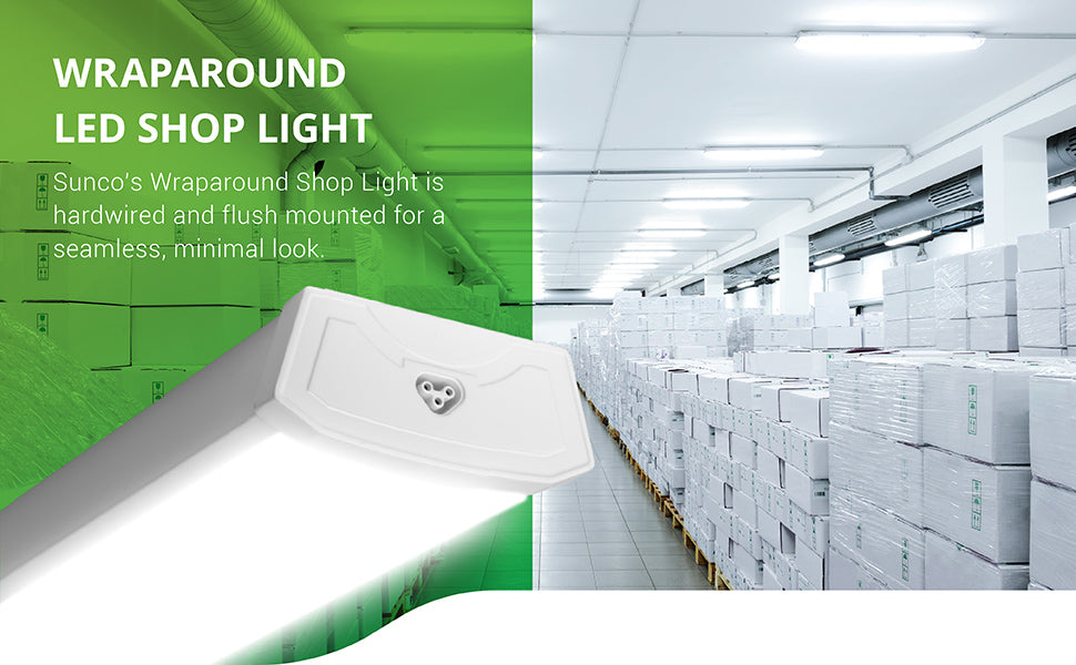 4ft Sunco Wraparound LED Shop Light is hardwired and can be flush mounted for a seamless, minimal look. Image shows a grocery storage warehouse with boxes on wood pallets. This 40W wraparound shop light is a 300W equivalent. Lights are placed on the ceiling and provide bright light to the space in this photo. A closeup of the Wraparound LED Shop Light has a diffused cover. The end cap includes a plug so 8 lights of this type can be linked together. Connecting cables are included.