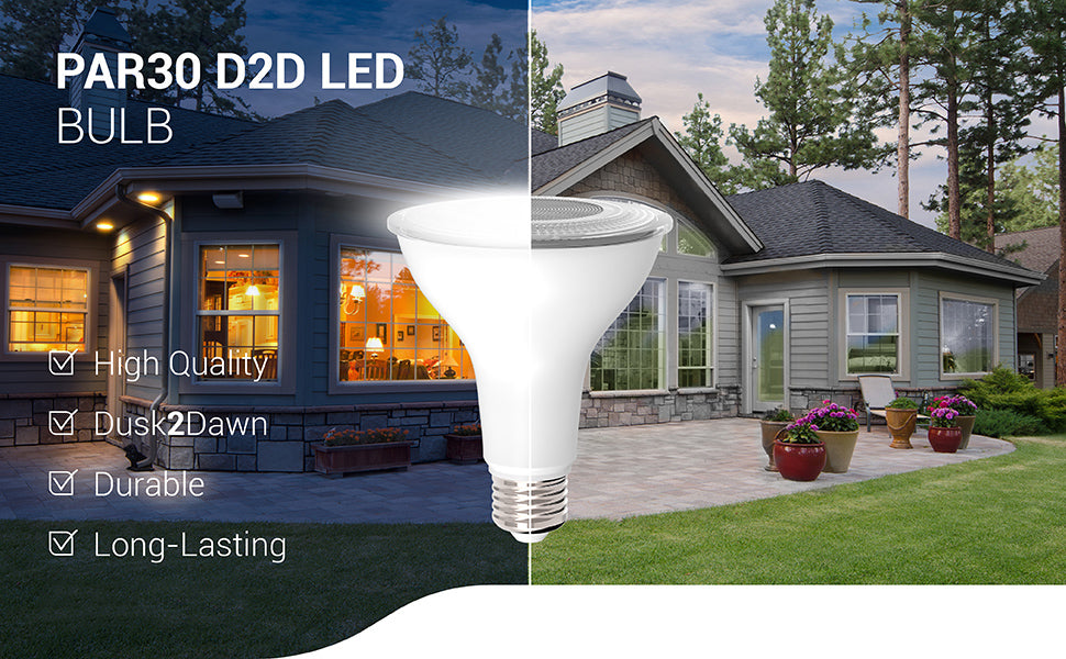 The long-lasting and durable PAR30 Dusk to Dawn LED Bulb is a high-quality light bulb with a built in Dusk to Dawn sensor to detect light levels and provide automated lighting. Wet rated for exterior use, this D2D LED turns on when no light is detected at night and turns off when light returns at dawn. Image shows a home with PAR30 Dusk to Dawn LEDs in 5- or 6- inch recessed cans for bright downlight.