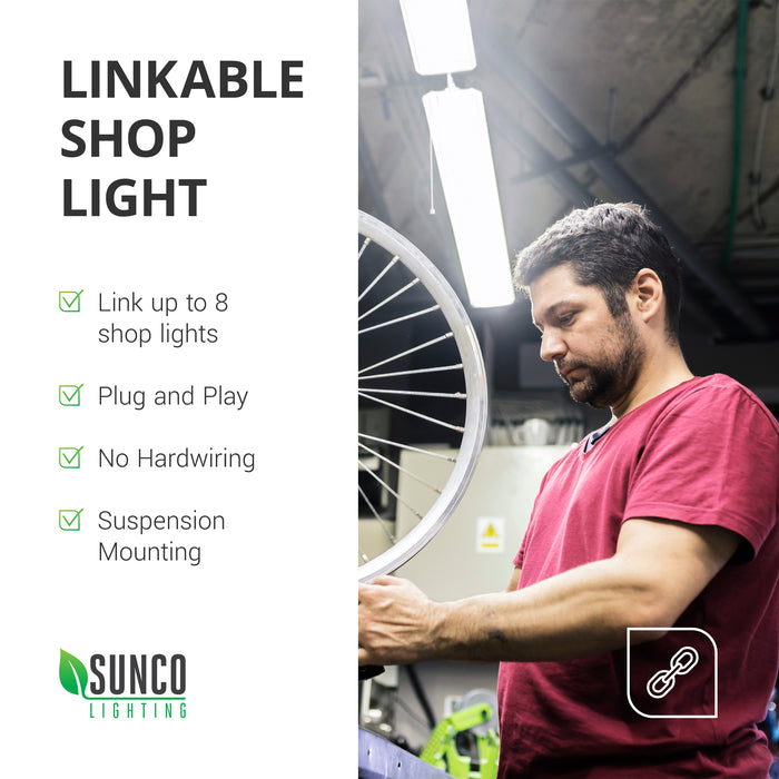 Linkable Shop Light. Link up to 8 shop lights together on the same power circuit. This is a plug and play light fixture. That means you can unbox it, install it, and use it quickly. There is no hardwiring required. Suspension mount this LED Shop Light for bright, long-lasting light in your workspace. Image shown here is of a bicycle mechanic, otherwise known as a wrench, who is working on the spokes of a wheel rim. Sunco shop lights are suspended above for overhead lighting.