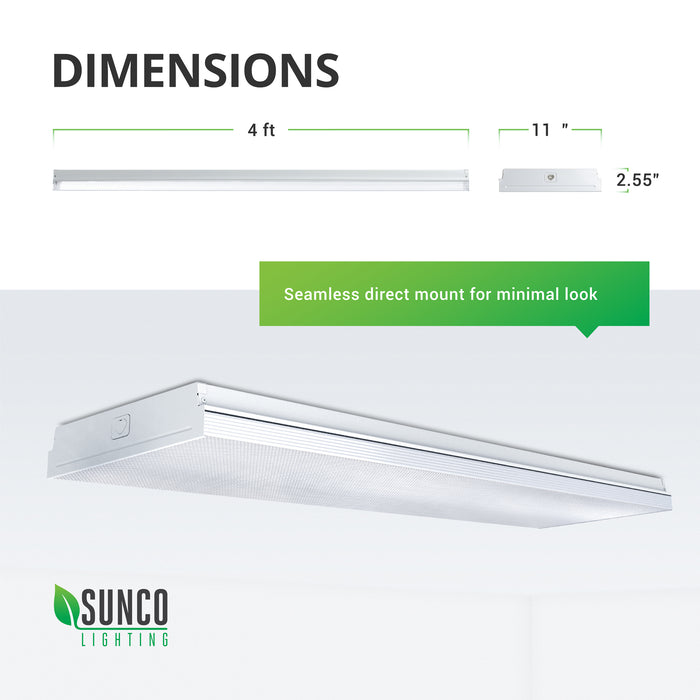 Dimensions of the wet rated Sunco 11-inch Prisma Wraparound LED Shop Light include: 4ft length, 11-inch width, 2.55-inch height. Image shows the seamless, minimal look of the surface mounted LED light fixture against a ceiling. Simply direct mount to your J-box to install.