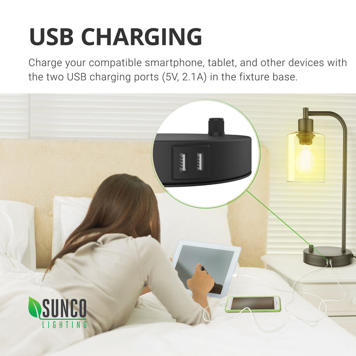 Easy USB Charging. Charge your compatible smartphone, tablet, and other devices with the two USB charging ports (5V, 2.1A) in the fixture base. Image shows a teen with tablet and smartphone charging in convenient USB ports on lamp base. Closeup of dual ports is shown in a callout. Works great as a nightstand lamp, like shown here, since you can dim to control light levels.