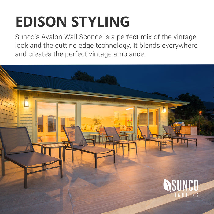 Edison Styling. Sunco's Avalon Wall Sconce with Dusk to Dawn is the ideal mix of vintage look and cutting edge technology with its ST64 LED Filament bulb in the retro styling of a bygone era. It works well in various lighting applications to create the ambiance you want. Image features a poolside patio with lounge chairs and multiple Sunco Avalon Caged Wall Sconces mounted on the home exterior walls.