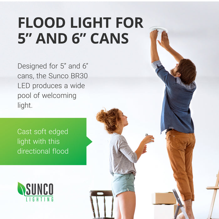 Perfect for 5-inch and 6-inch cans. Sunco's BR30 LED light bulb fits in both 5-inch and 6-inch recessed cans to deliver a wide flood light to your living room, workspace, kitchen, retail showroom, and many other commercial applications. Here a young couple changes out a light bulb as they move into their new home with moving boxes around them.