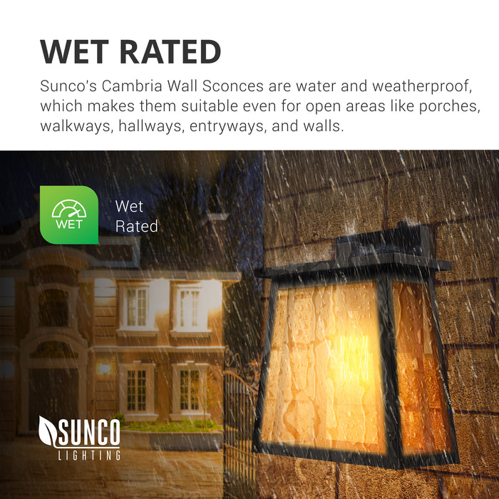 Wet Rated. Sunco Lighting's Cambria Wall Sconces are water and weatherproof with an IP65 rating. They are suitable for open areas like porches, walkways, exterior hallways, entrances, and along walls. The Cambria Caged Wall Sconce is pictured here on an exterior wall at a house in the rain. Since it is nighttime, the built-in Dusk to Dawn sensor has automatically turned on the light bulb.
