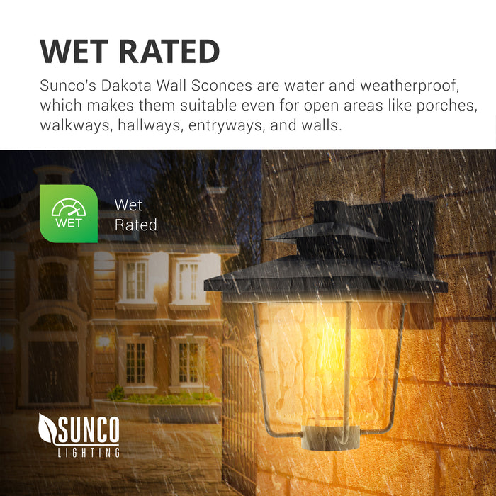 Wet Rated. Sunco Lighting's Dakota Wall Sconces are water and weatherproof with an IP65 rating. They are suitable for open areas like porches, walkways, exterior entrances, and along walls. The Dakota Caged Wall Sconce is pictured here installed at a house with rain coming down. The frame is rust-resistant for a long lifetime of quality lighting. The built-in Dusk to Dawn sensor automatically turns on the bulb at night. The seeded glass shade provides a stylish accent to any exterior wall.