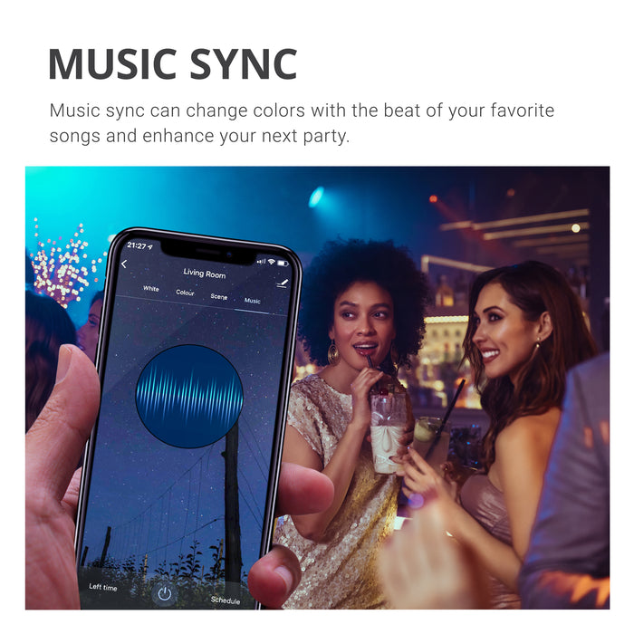 Music Sync can change colors with the beat of your favorite songs and enhance your next party. Image shows friends dancing together under changing light bulb colors of a PAR30 LED Smart Bulb. Image includes a closeup of a smart phone showing the Music Sync setting options on a smart phone. You can use a compatible tablet, too. Just keep the smart device, the smart bulb, and your music in the same room and your lights can dance to the beat with you.