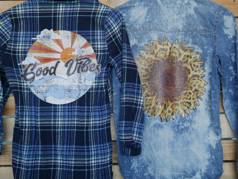 "Multicolored blue flannel with ""Good Vibes"" image with cloud and a sunburst. Jean long sleeve with a cheetah print sunflower image."
