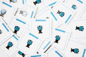 "Sneaker News ""Reading Man"" Pin"