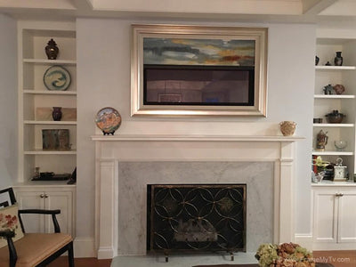 framed tv over fireplace