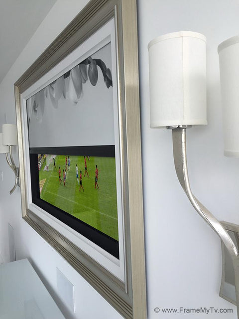 tv frame with motorized art cover