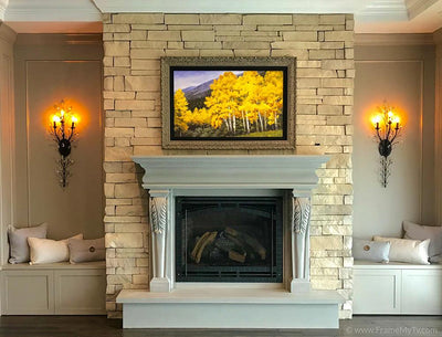 Framed art over fireplace