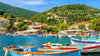 Colorful Greek fishing boats in port of Kioni to Hide a TV
