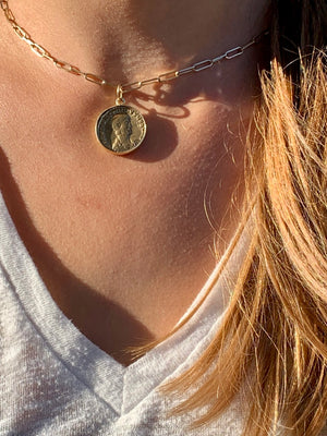 GOLD AND BRASS AMULET CHARM NECKLACE