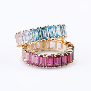 BLUE AND PINK TOPAZ EMERALD CUT ETERNITY BAND