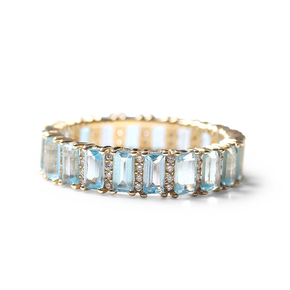 BLUE TOPAZ AND DIAMOND BAGUETTE CUT ETERNITY BAND