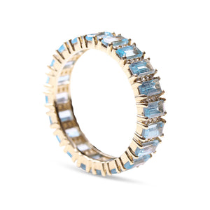 BLUE TOPAZ AND DIAMOND BAGUETTE CUT ETERNITY RING