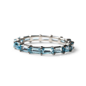 BLUE TOPAZ BAGUETTE ETERNITY BAND