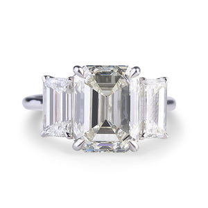 THREE STONE EMERALD CUT ENGAGEMENT RING