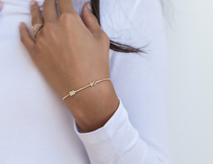 gold snd diamond arrow bangle