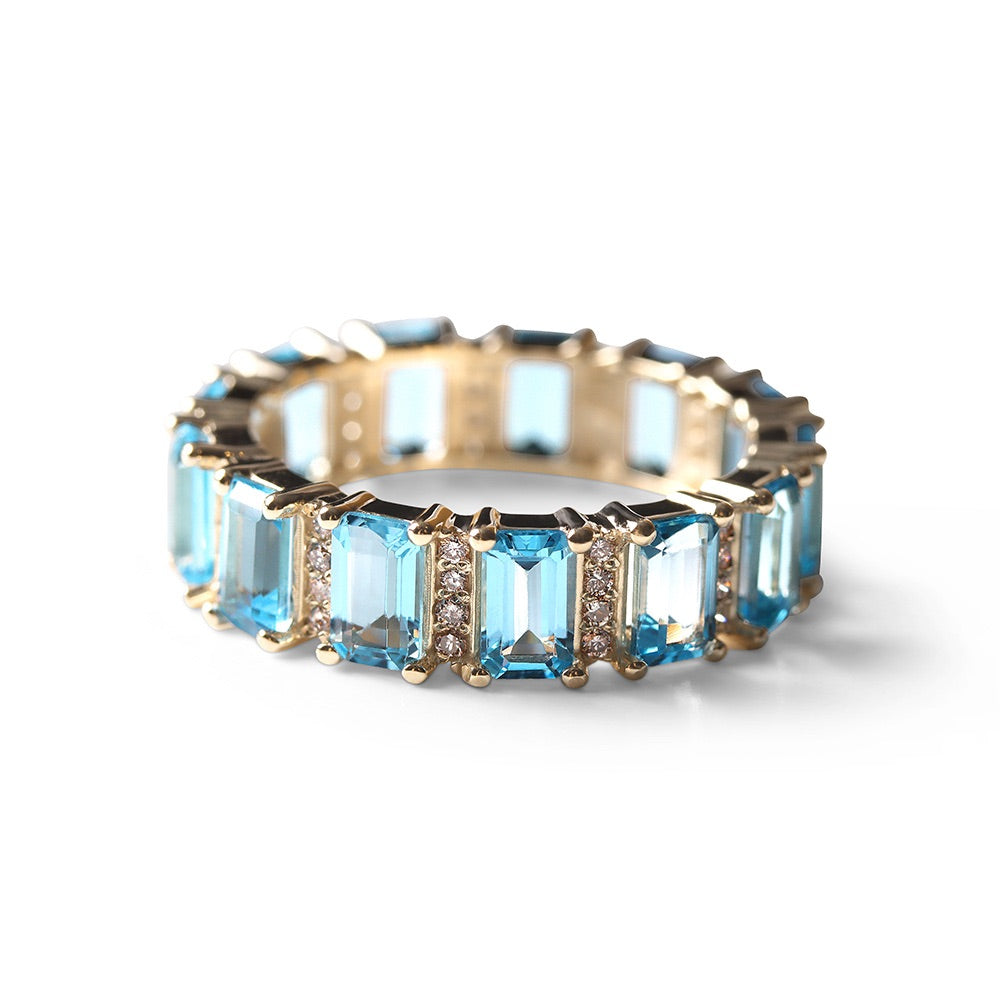 BLUE TOPAZ AND DIAMOND EMERALD CUT ETERNITY BAND