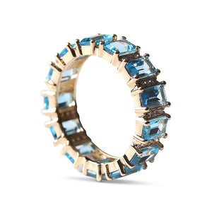 BLUE TOPAZ AND DIAMOND AND EMERALD CUT ETERNITY RING