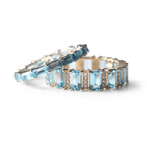 BLUE TOPAZ AND DIAMOND ETERNITY BAND