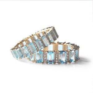 TOPAZ AND DIAMOND EMERALD CUT ETERNITY BAND