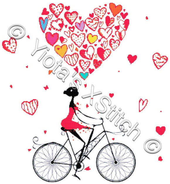 Love bicycle, a lady on her bike counted cross stitch kit