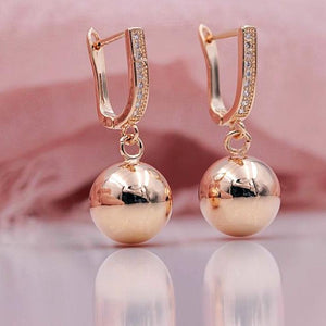 585 Rose Gold Ball Earrings - trinkets.pk