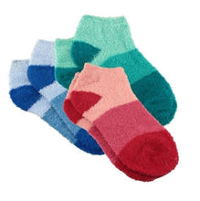 Three pairs of red, blue, and green aloe infused ankle socks. Each pair of socks feature a design with three various shades of the same color, with darker areas at the toe and heel areas.