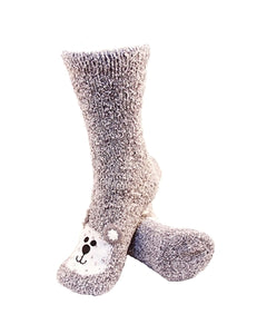 One pair of grey fuzzy socks. There is a playful polar bear face stitched into the top of the foot section of the sock. The sock is crew length, going a few inches over the ankle.