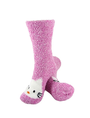 One pair of bright pink fuzzy socks. There is a playful Hello Kitty face stitched into the top of the foot section of the sock. The sock is crew length, going a few inches over the ankle.