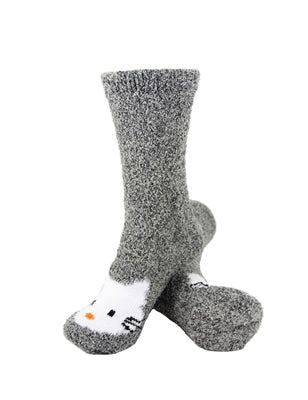 One pair of grey fuzzy socks. There is a playful Hello Kitty face stitched into the top of the foot section of the sock. The sock is crew length, going a few inches over the ankle.
