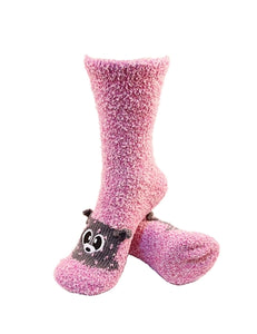 One pair of pink fuzzy socks. There is a playful raccoon face stitched into the top of the foot section of the sock. The sock is crew length, going a few inches over the ankle.