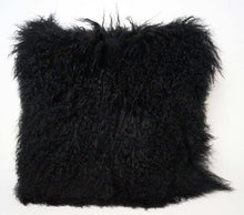 A square pillow made of tibetan sheep fur. The fur is approximate two inches in length and is black colored.