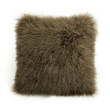 A square pillow made of tibetan sheep fur. The fur is approximate two inches in length and is lichen colored.