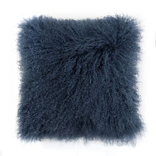 A square pillow made of tibetan sheep fur. The fur is approximate two inches in length and is mare colored.