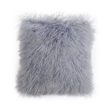A square pillow made of tibetan sheep fur. The fur is approximate two inches in length and is dove colored.