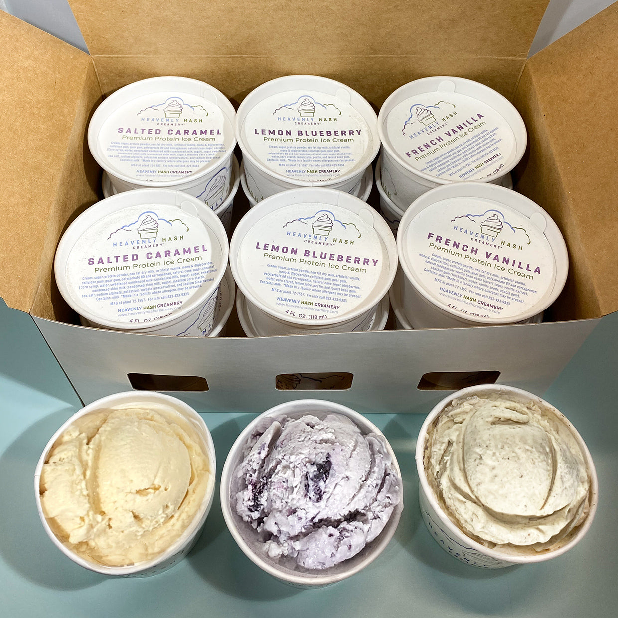 Our Variety Pack of 3 flavors including (4) Salted Caramel, (4) Lemon Blueberry, (4) French Vanilla shown in the 12-pack carton with a Heavenly Hash Creamery cup open and filled with delicious high protein ice cream.
