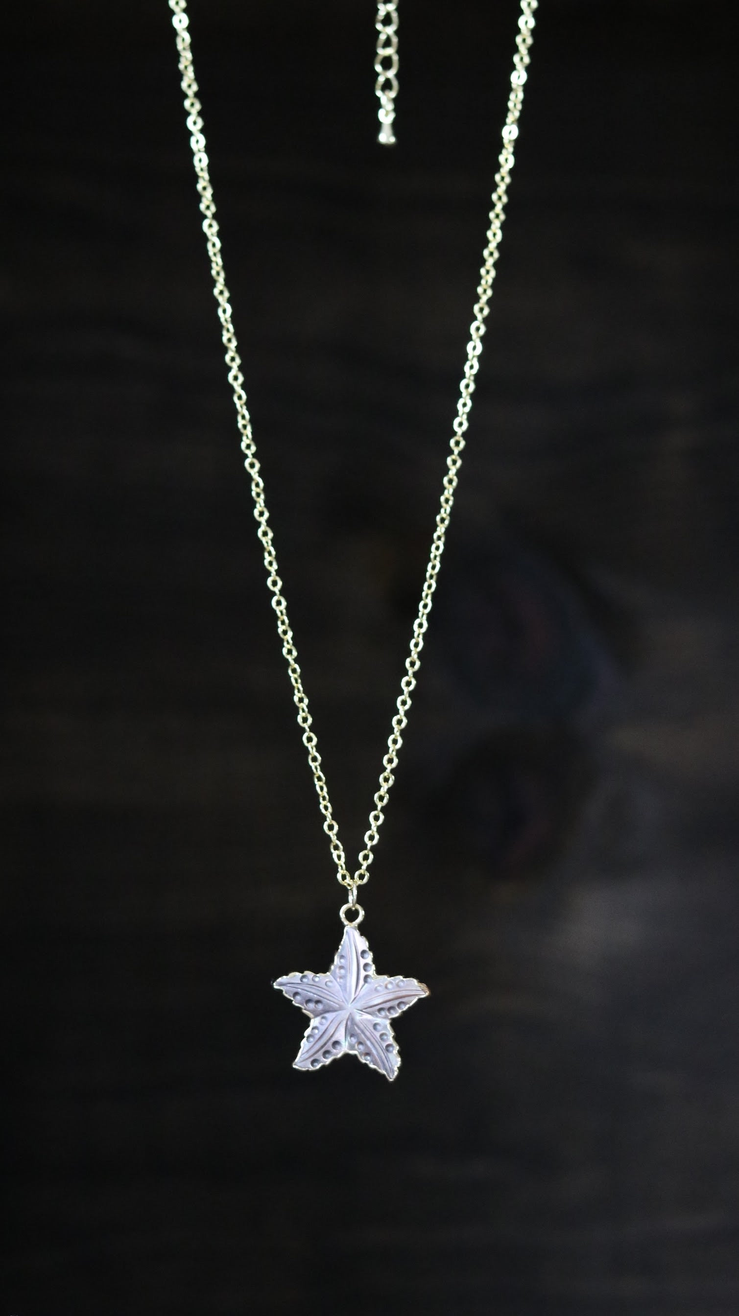Light brown carved starfish necklace